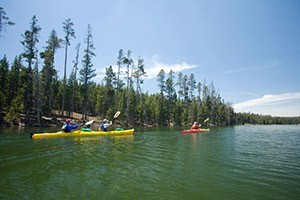OARS - Yellowstone & Teton Park getaways :: Enjoyable all-inclusive vacations sure to engage and excite all age groups. From kayaking pristine lakes, hike to waterfalls, raft the Snake River to private island camping.