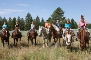 Yellowstone Horses - trail rides on private ranch :: Family-style mountain & meadow horseback rides. Great horses, great guides, reasonable rates and fantastic trails near Yellowstone's west entrance. Cowboy cookouts too.