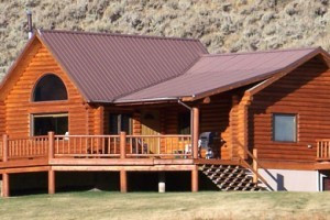 Wilderness Edge - Log Lodges & Family Cabins :: Modern, large log lodges and 1- or 2-bedroom simpler cabins 35 minutes to West Yellowstone. Private access to uncrowded mountain lake; 10 minutes from famous Madison River.