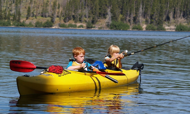 Kids Kayaking and Fishing in West Yellowstone Montana